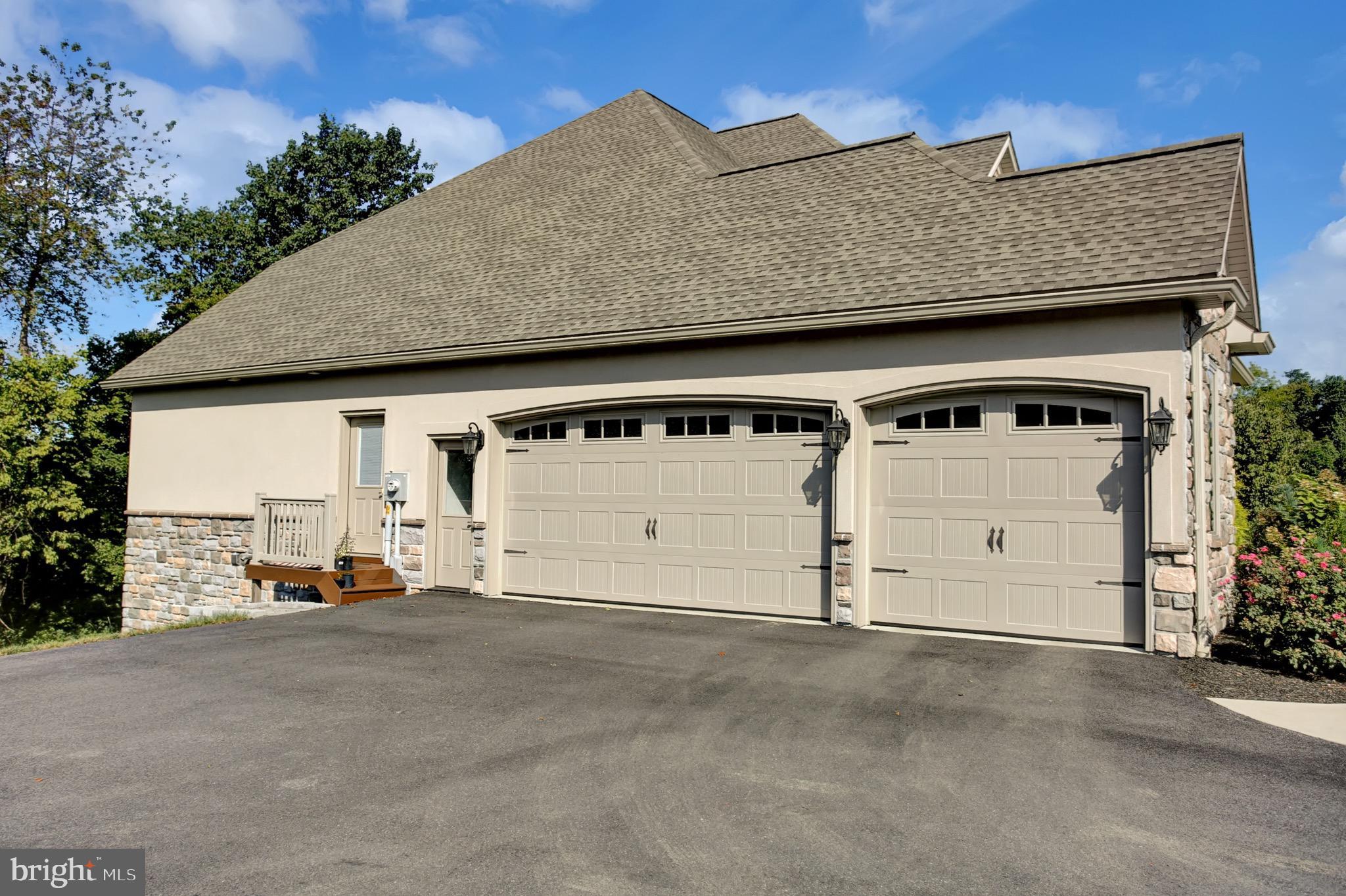Single door entries directly to garage & mudroom.