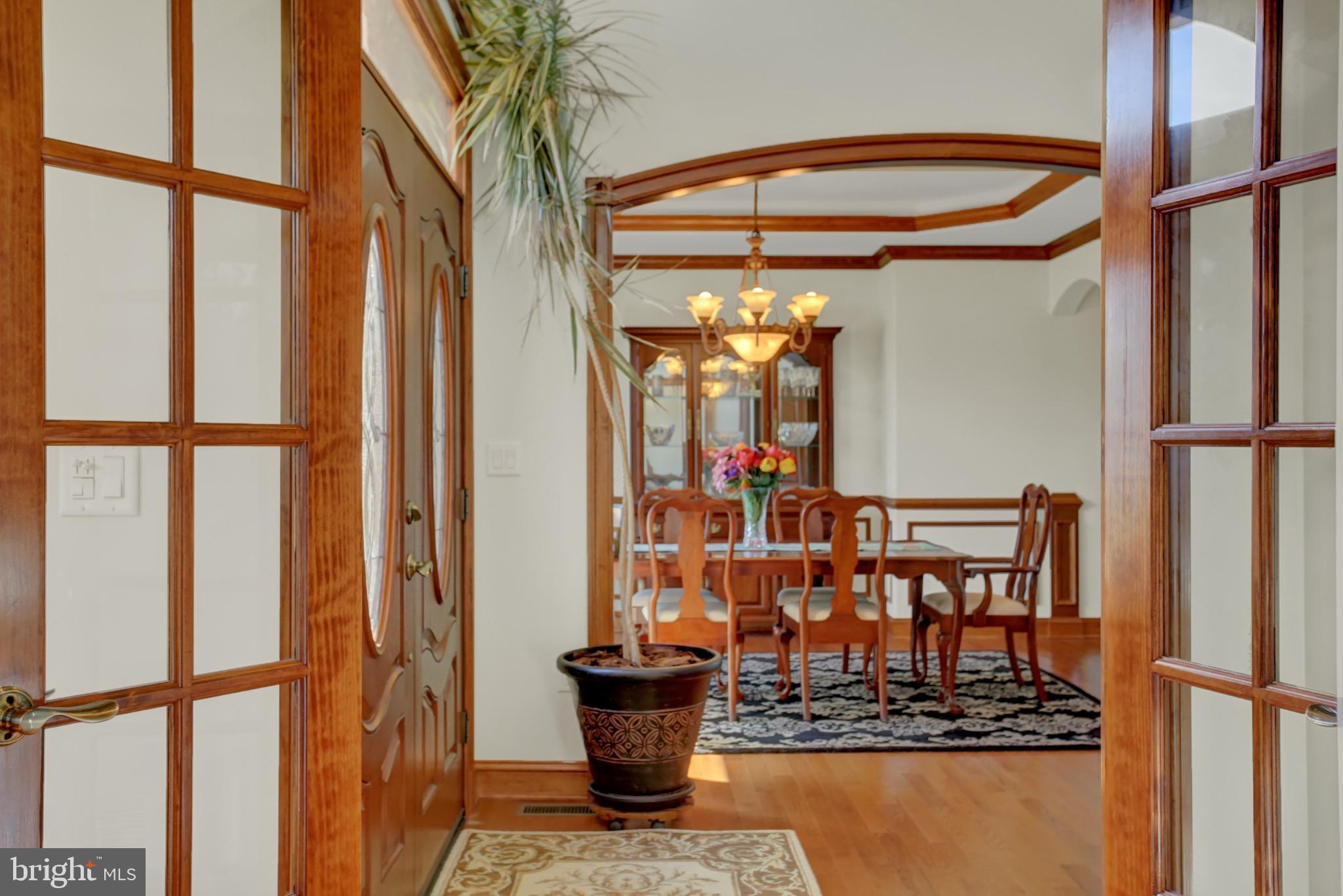 Living room double glass doors open onto foyer.