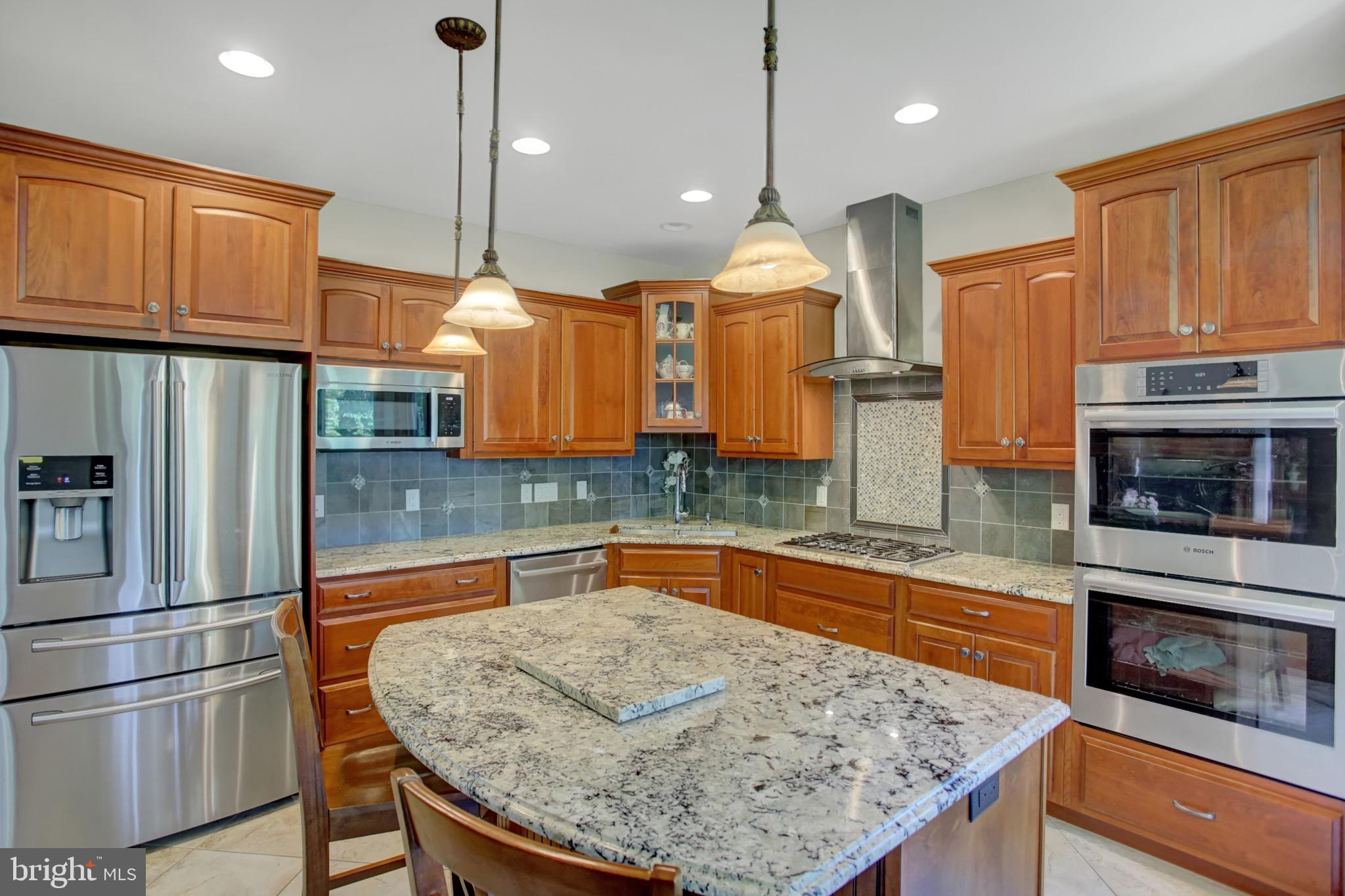 Gourmet kitchen with granite countertop island.