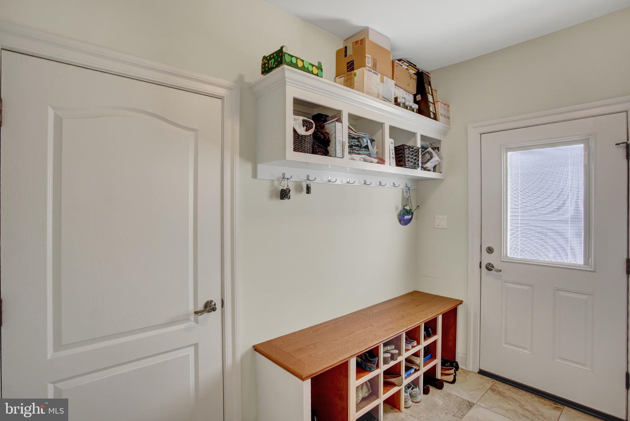 Mudroom with built ins and exterior access