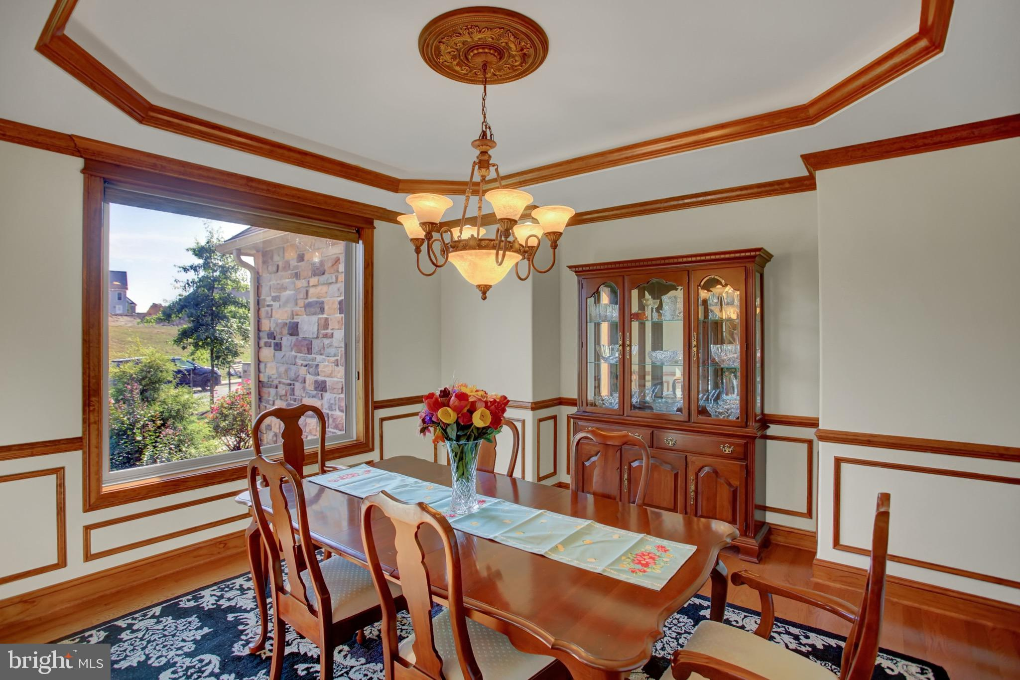Dining room with custom wood work and tray ceiling