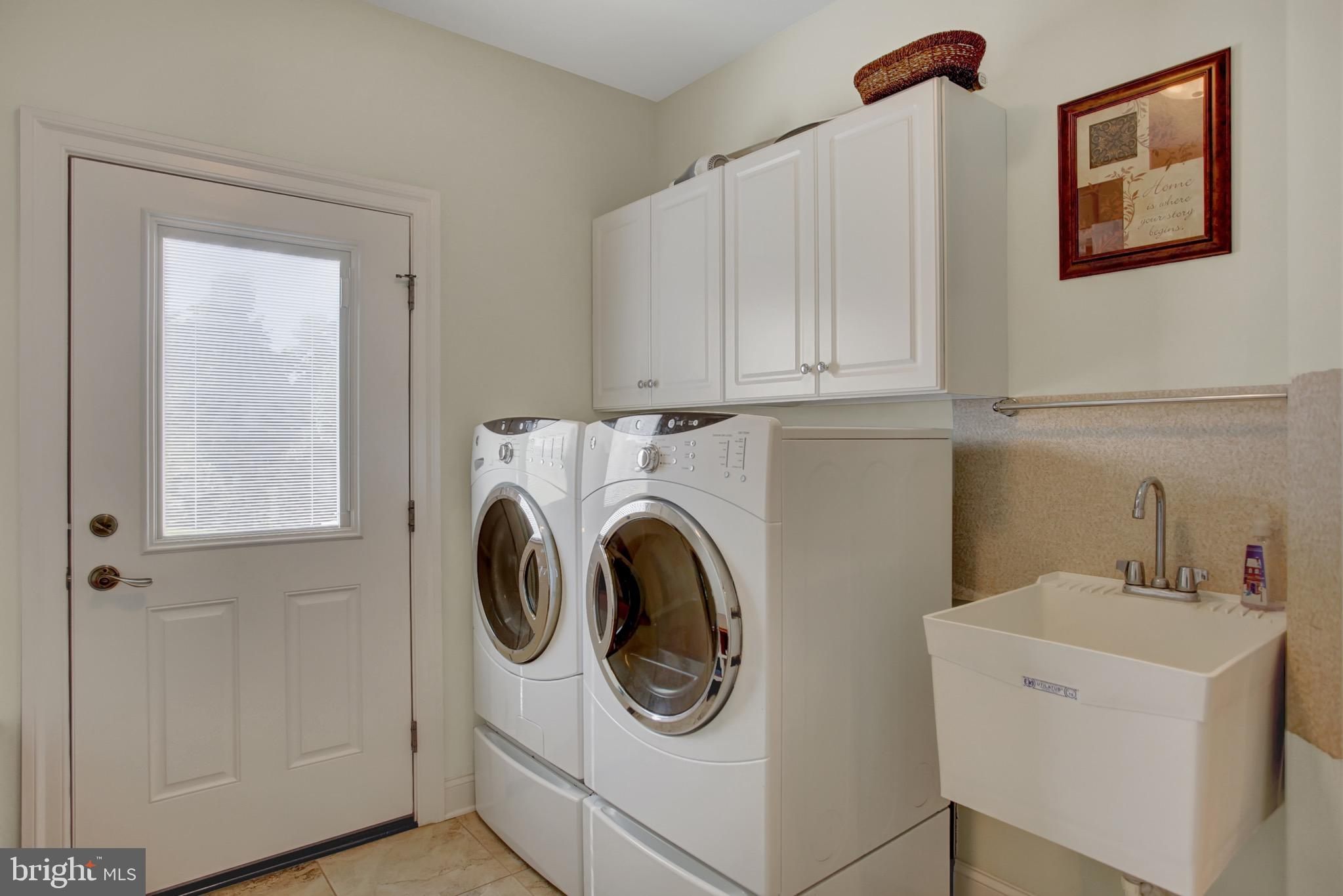 Mudroom with utility sink and cabinets