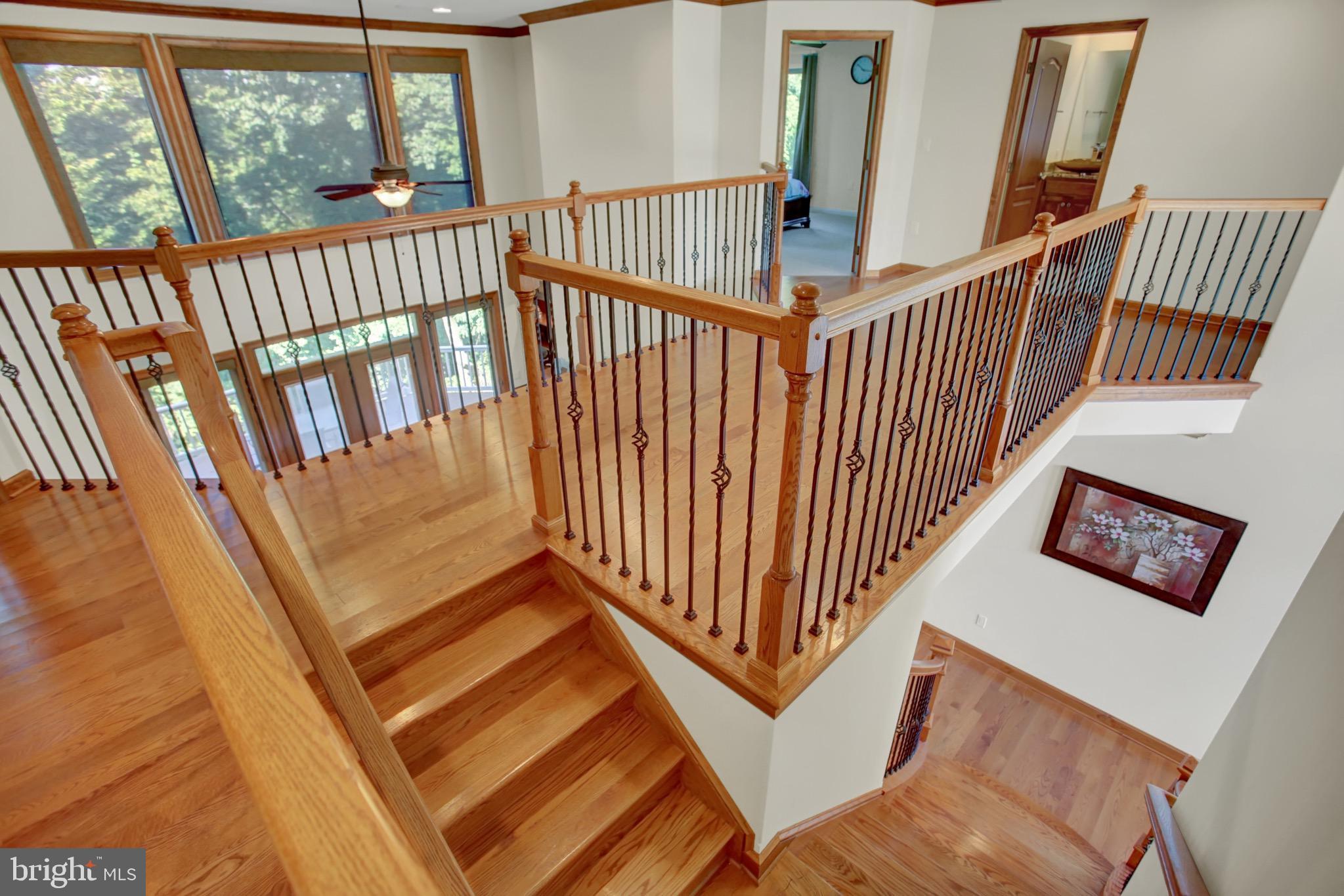 Open 2nd floor overlook with hardwood floors.