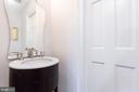 Main Floor Powder Room with Pocket Doors - 6014 GROVE DR, ALEXANDRIA