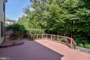 Large deck overlooks part of the .42 acre lot - 7428 SPRING SUMMIT RD, SPRINGFIELD