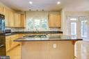 Big island with an upgraded cooktop - 7428 SPRING SUMMIT RD, SPRINGFIELD