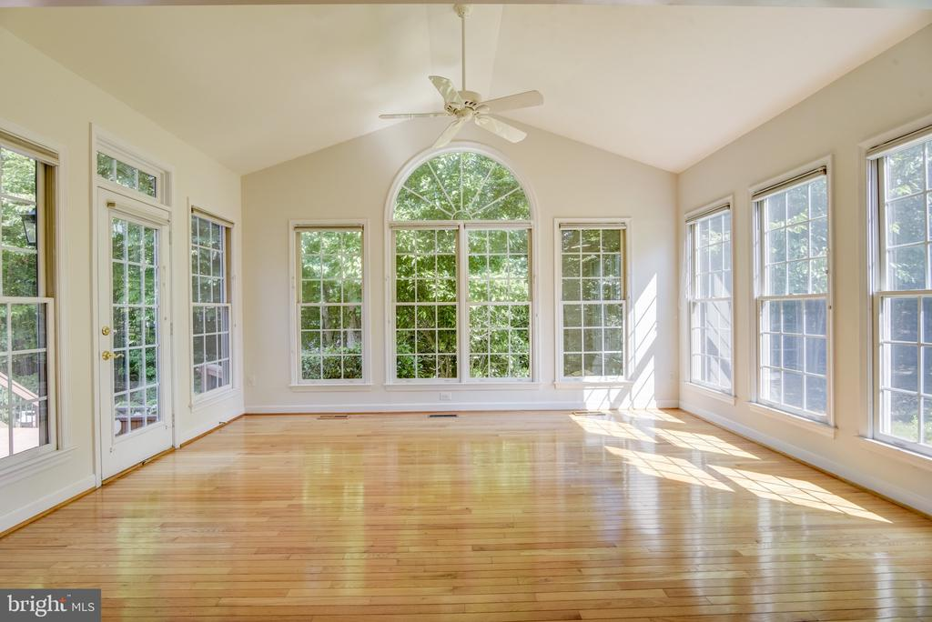 From the family room to this gorgeous sun room! - 7428 SPRING SUMMIT RD, SPRINGFIELD