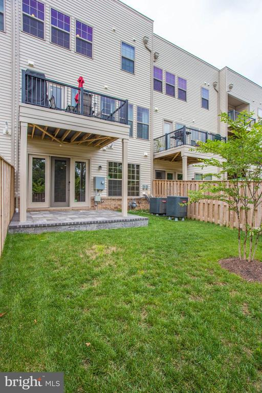 Backyard  with Stone Patio and Deck - 23384 NANTUCKET FOG TER, BRAMBLETON