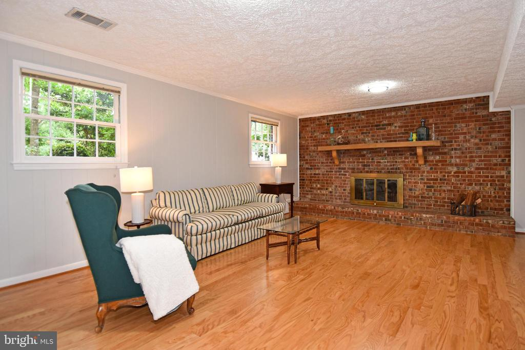 Lower level family room- wood burning fireplace - 5024 PORTSMOUTH RD, FAIRFAX