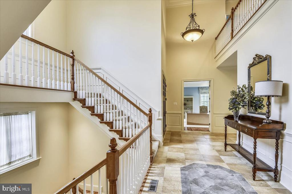 Love this grand staircase in the foyer - 12056 OPEN RUN RD, ELLICOTT CITY