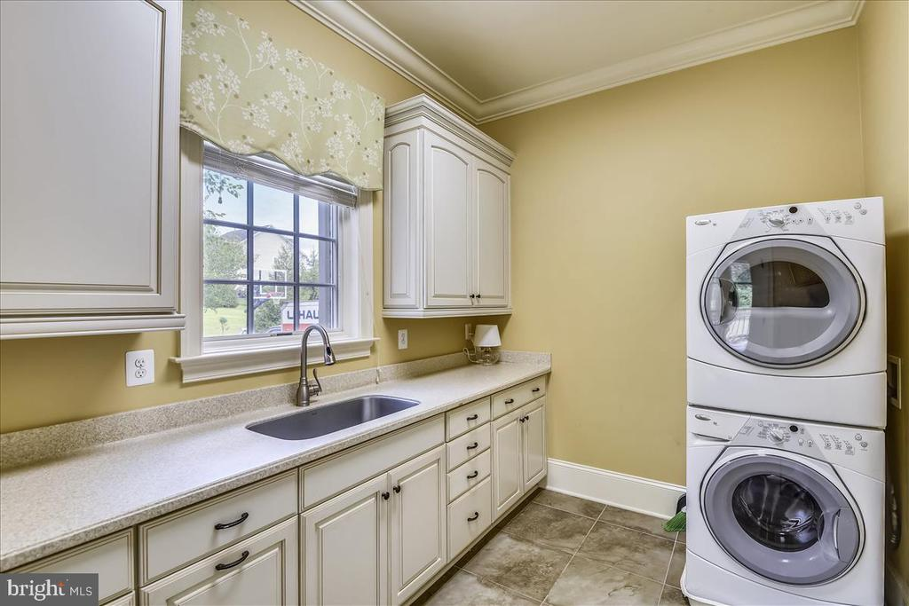 Main level Laundry room with garage and patio acce - 12056 OPEN RUN RD, ELLICOTT CITY