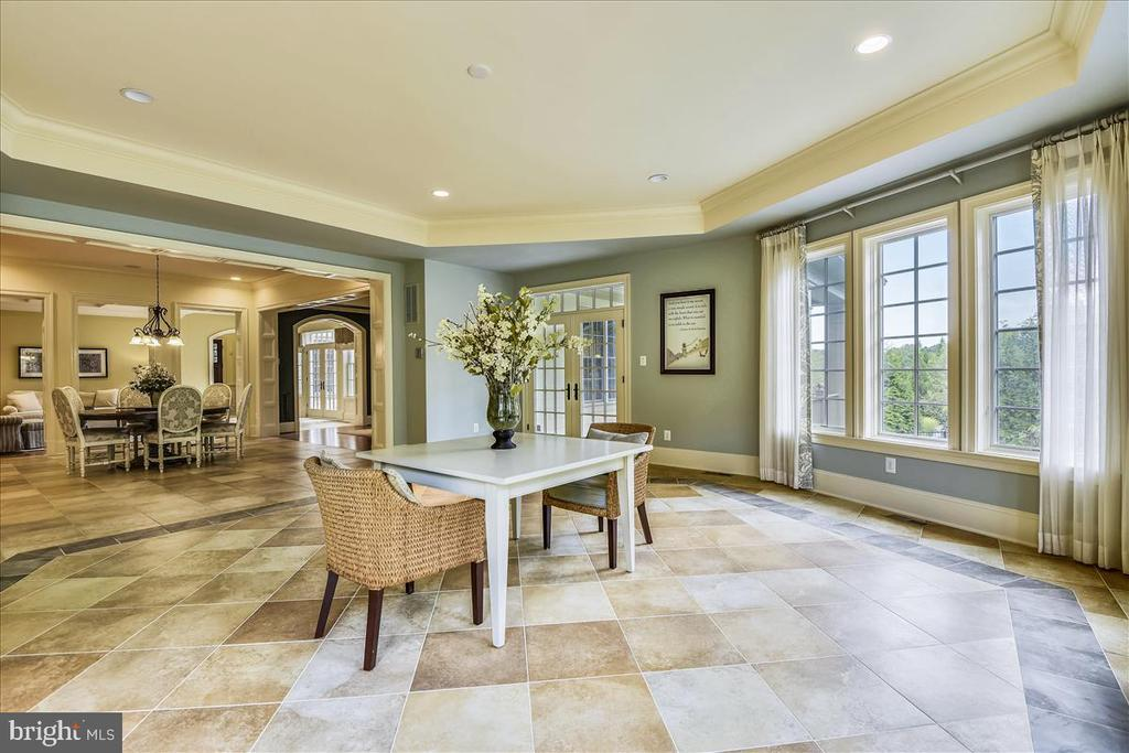 Opens to the kitchen and eating area - 12056 OPEN RUN RD, ELLICOTT CITY