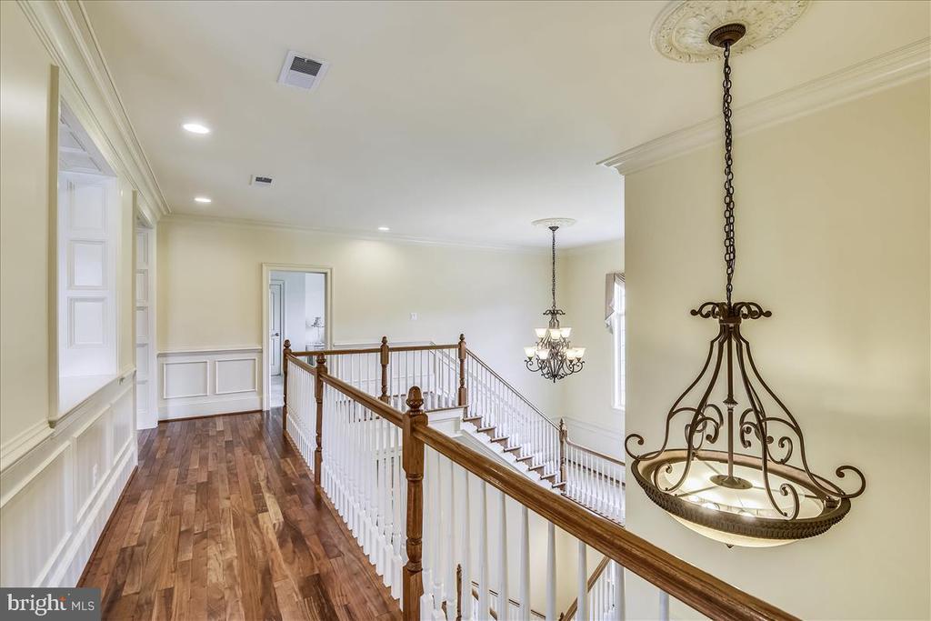 Upstairs walkway with gorgeous flooring - 12056 OPEN RUN RD, ELLICOTT CITY