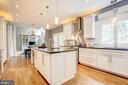 Kitchen opens to family room. - 47771 BRAWNER PL, POTOMAC FALLS
