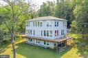 Rear of home with lots of windows to see view. - 74 WOODCUTTERS LN, HARPERS FERRY