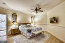 Master bedroom with wainscoting and ceiling fan - 121 TREEHAVEN ST, GAITHERSBURG