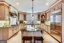 Kitchen with huge granite-topped island - 121 TREEHAVEN ST, GAITHERSBURG