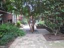 Building courtyard with community bike racks. - 2201 2ND ST NW #21, WASHINGTON