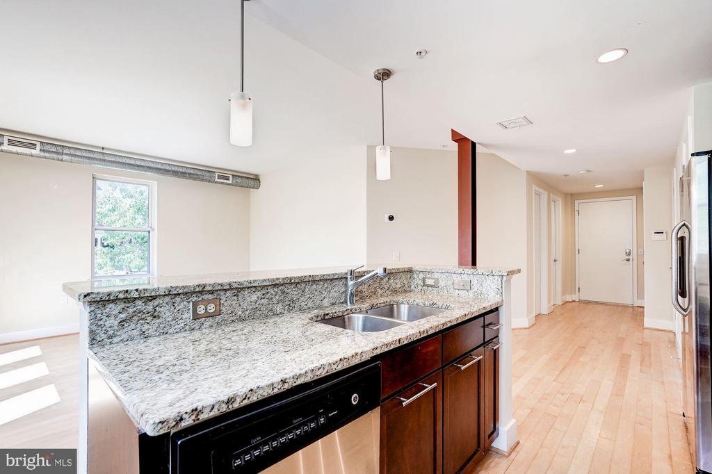 Island in kitchen with 7' breakfast bar. - 2201 2ND ST NW #21, WASHINGTON