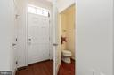 Hardwood foyer with powder room - 5925 SHEPHERD LN, FREDERICK