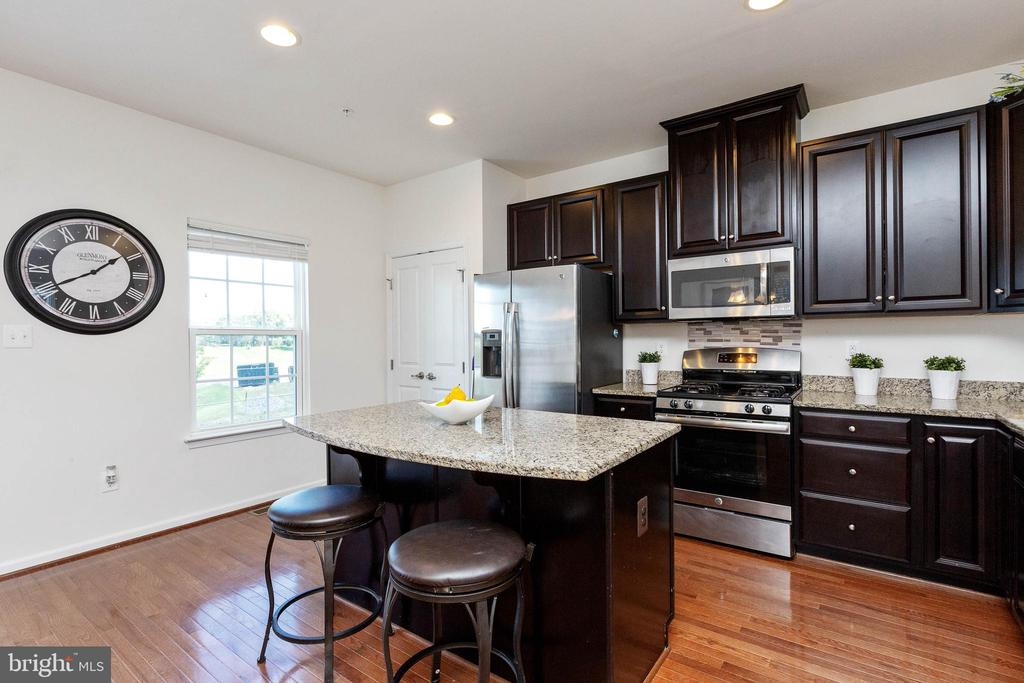Kitchen with granite countertops and island - 5925 SHEPHERD LN, FREDERICK
