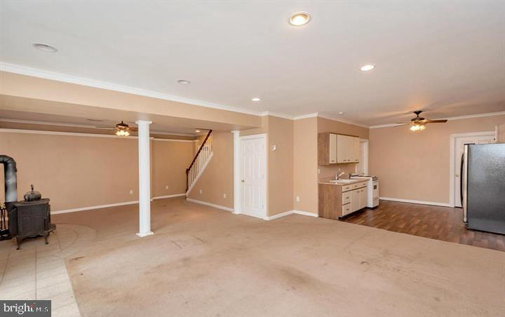 FINISHED BASEMENT W/WOOD STOVE - 30322 STONEWALL DR, LOCUST GROVE