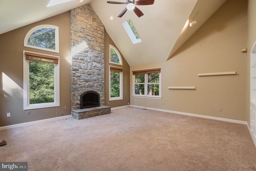 Two-story family room with wood-burning stone FP - 3276 HISTORY DR, OAKTON
