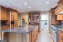 Kitchen island w/sink, dishwasher & breakfast bar - 3276 HISTORY DR, OAKTON