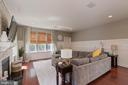 Bright and roomy family room; custom wainscoting - 23337 MORNING WALK DR, BRAMBLETON