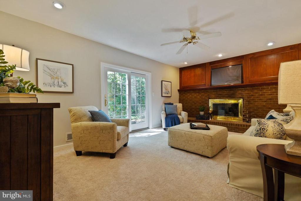 Family room off kitchen with views to rear yard. - 11715 BLUE SMOKE TRL, RESTON