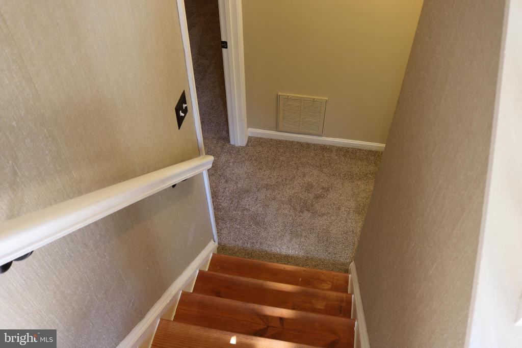 Stairs to lower level - 49 MEADOWOOD DR, STAFFORD