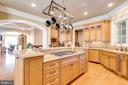 Kitchen Enjoys Views to Great Room - 2479 OAKTON HILLS DR, OAKTON