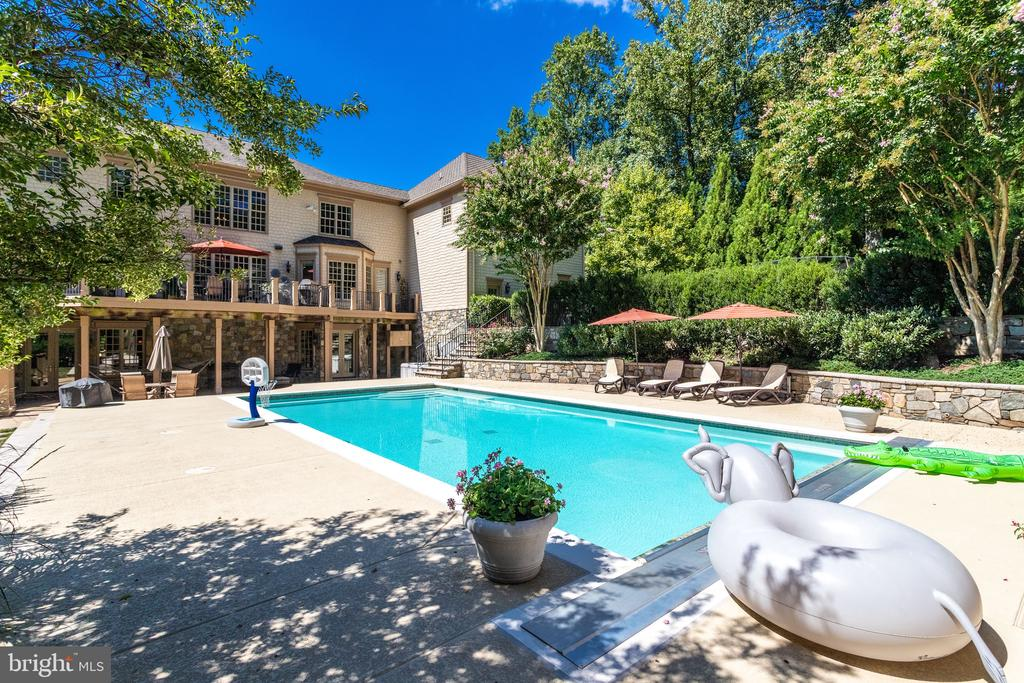 Beautiful Stone Wall Nestles Pool Deck - 2479 OAKTON HILLS DR, OAKTON