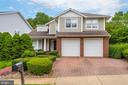 Contemporary styled home sited on a corner lot - 20456 TAPPAHANNOCK PL, STERLING