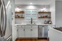Remodeled kitchen w floating shelving - 20456 TAPPAHANNOCK PL, STERLING