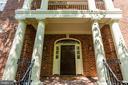Majestic front door with upper level veranda - 1843 HUNTER MILL RD, VIENNA