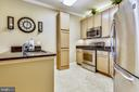 Kitchen with granite counters & stainless steel. - 1391 PENNSYLVANIA AVE SE #402, WASHINGTON