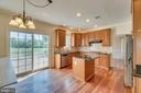 Kitchen with view out on the golf course - 20210 HIDDEN CREEK CT, ASHBURN