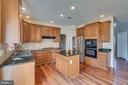 Kitchen with island and Granite counter tops - 20210 HIDDEN CREEK CT, ASHBURN