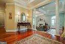 Foyer with gleaming hardwood and crown molding. - 1011 N WASHINGTON ST, ALEXANDRIA