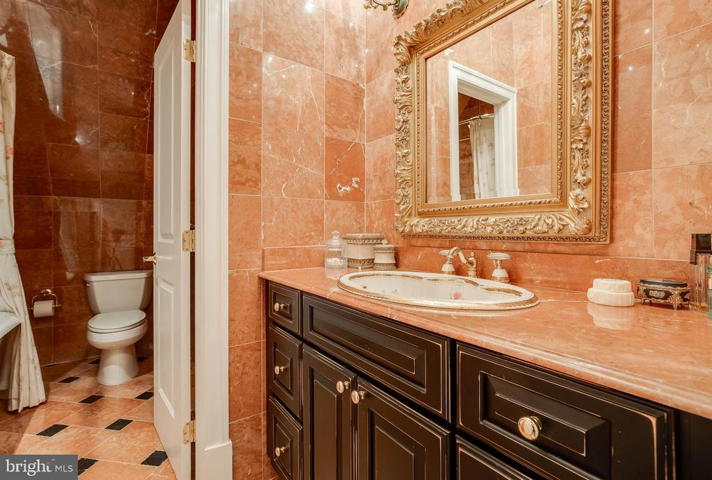 Sophisticated hall bath with clawfoot tub. - 1011 N WASHINGTON ST, ALEXANDRIA