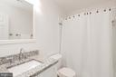 Updated hall bath with tub. - 11005 BIRDFOOT CT, RESTON