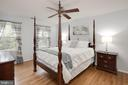 Spacious upper level 2nd bedroom with hardwoods. - 11005 BIRDFOOT CT, RESTON