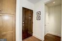 Front door entrance into foyer and coat closet - 1418 N RHODES ST #B102, ARLINGTON