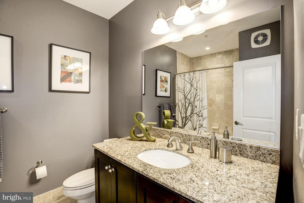 Second bedroom features Travertine Tile and bath - 1418 N RHODES ST #B102, ARLINGTON