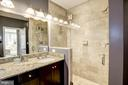 Master ensuite bath features Travertine Tile - 1418 N RHODES ST #B102, ARLINGTON
