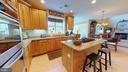 Kitchen with Island - 20386 CLIFTONS POINT ST, POTOMAC FALLS