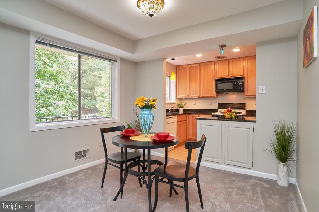 Dining Area/View of Kitchen - 10607 KENILWORTH AVE #K-104, BETHESDA