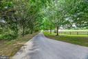 Long tree lined drive - 13224 LONGNECKER RD, GLYNDON