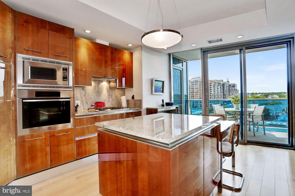 Kitchen with Center Island and Space for a Table - 1881 N NASH ST #1202, ARLINGTON